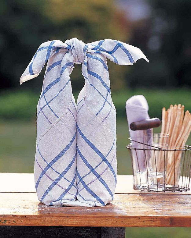 DIY Picnic Ideas - Tablecloth Bottle Wrap - Cool Recipes and Tips for Picnics and Meals Outdoors - Recipes, Easy Sandwich Wraps, Blankets, Baskets and Carriers to Make for Fun Family Outings and Romantic Date Ideas - Mason Jar Drinks, Snack Holders, Utensil Caddy and Picnic Hacks http://diyjoy.com/diy-picnic-ideas