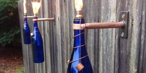 She Brilliantly Recycles Her Wine Bottles For Great Summer Night Ambience Keeping Mosquitos Away!