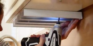 He Screws Racks Under His Cabinets And What He Puts In Them Is So Clever!
