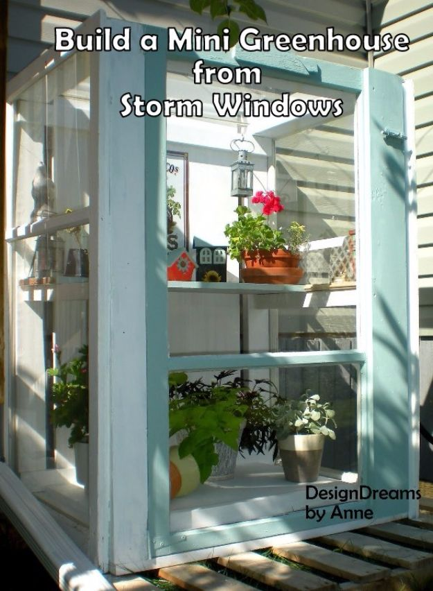 DIY Ideas With Old Windows - Build A Mini Greenhouse From Storm Windows - Rustic Farmhouse Decor Tutorials and Projects Made With An Old Window - Easy Vintage Shelving, Coffee Table, Towel Hook, Wall Art, Picture Frames and Home Decor for Kitchen, Living Room and Bathroom - Creative Country Crafts, Seating, Furniture, Patio Decor and Rustic Wall Art and Accessories to Make and Sell http://diyjoy.com/diy-projects-old-windows