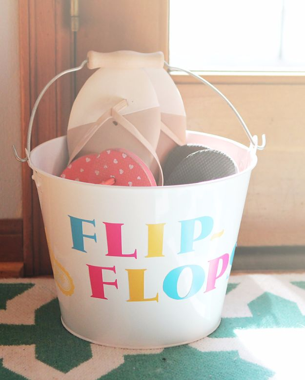 DIY Hacks for Summer - DIY Family Flip Flops Bucket - Easy Projects to Try This Summer To Get Organized, Spend Time Outdoors, Play With The Kids, Stay Cool In The Heat - Tips and Tricks to Make Summertime Awesome - Crafts and Home Decor by DIY JOY http://diyjoy.com/diy-hacks-summer