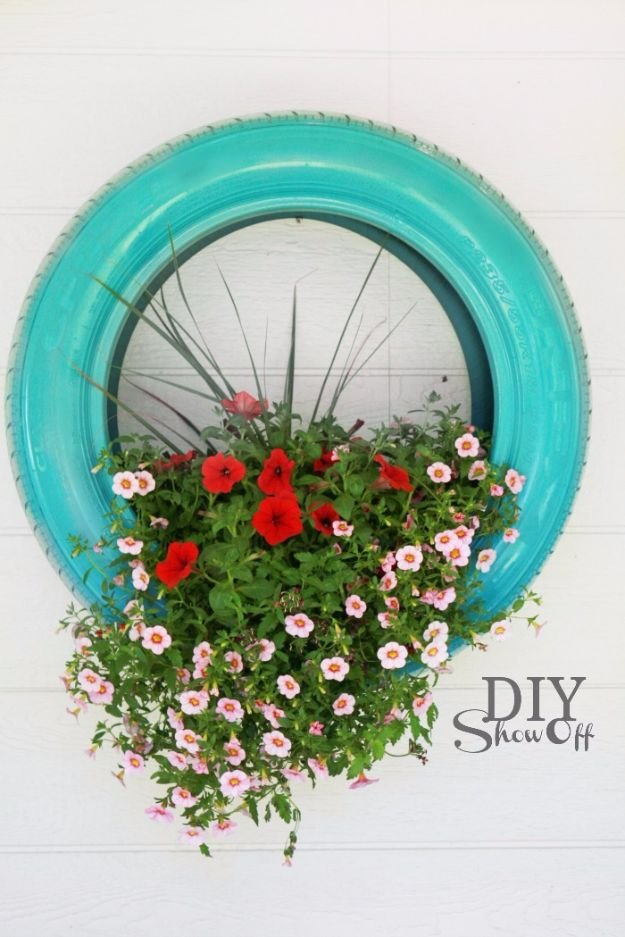 DIY Ideas With Old Tires - DIY Hanging Tire Planter - Rustic Farmhouse Decor Tutorials and Projects Made With An Old Tire - Easy Vintage Shelving, Wall Art, Swing, Ottoman, Seating, Furniture, Gardeing Ideas and Home Decor for Kitchen, Living Room, Bathroom and Backyard - Creative Country Crafts, Rustic Wall Art and Accessories to Make and Sell http://diyjoy.com/diy-projects-old-tires