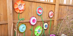 Watch How She Brightens Up Her Backyard With Dollar Store Plates And Cups (Genius!)