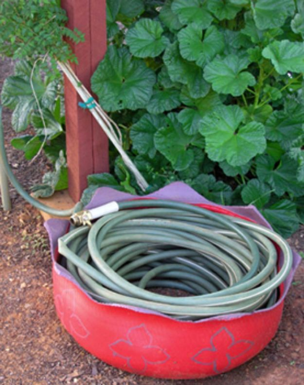 DIY Ideas With Old Tires - Hose Roller - Rustic Farmhouse Decor Tutorials and Projects Made With An Old Tire - Easy Vintage Shelving, Wall Art, Swing, Ottoman, Seating, Furniture, Gardeing Ideas and Home Decor for Kitchen, Living Room, Bathroom and Backyard - Creative Country Crafts, Rustic Wall Art and Accessories to Make and Sell http://diyjoy.com/diy-projects-old-tires