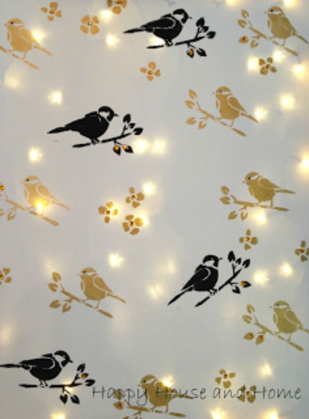 DIY Stencil Ideas - Stencil Canvas With Twinkle Lights - Cool and Easy Stenciling Tutorials For Making Handmade Wallpaper and Designs, Furniture Makeover Ideas and Crafty Modern Decor With Stencils - Rustic Farmhouse Paint Techniques and Step by Step Instructions for Using Stencil Art in Your Living Room, Bedroom, Bathroom and Crafts http://diyjoy.com/diy-stencil-ideas-projects