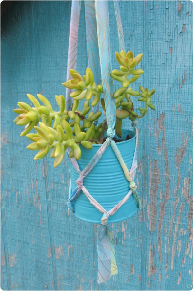 DIY Ideas With Old Tin Cans - Tin Can Hanging Planter - Rustic Farmhouse Decor Tutorials and Projects Made With An Old Tin Can - Easy Vintage Shelving, Wall Art, Picture Frames and Home Decor for Kitchen, Living Room and Bathroom - Creative Country Crafts, Craft Room Storage, Silverware Holder, Rustic Wall Art and Accessories to Make and Sell http://diyjoy.com/diy-projects-tin-cans