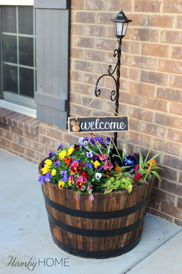 Best Country Decor Ideas for Your Porch - Whiskey Barrel Planter - Rustic Farmhouse Decor Tutorials and Easy Vintage Shabby Chic Home Decor for Kitchen, Living Room and Bathroom - Creative Country Crafts, Furniture, Patio Decor and Rustic Wall Art and Accessories to Make and Sell http://diyjoy.com/country-decor-ideas-porchs