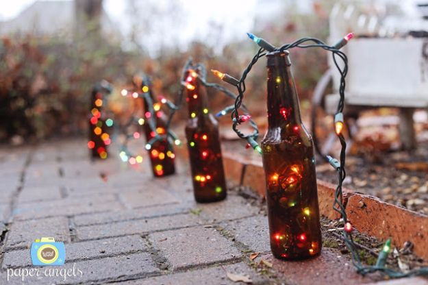 DIY Outdoor Lighting Ideas - Beer Bottle Lights - Do It Yourself Lighting Ideas for the Backyard, Patio, Porch and Pool - Lights, Chandeliers, Lamps and String Lights for Your Outdoors - Dining Table and Chair Lighting, Overhead, Sconces and Weatherproof Projects #diy #lighting