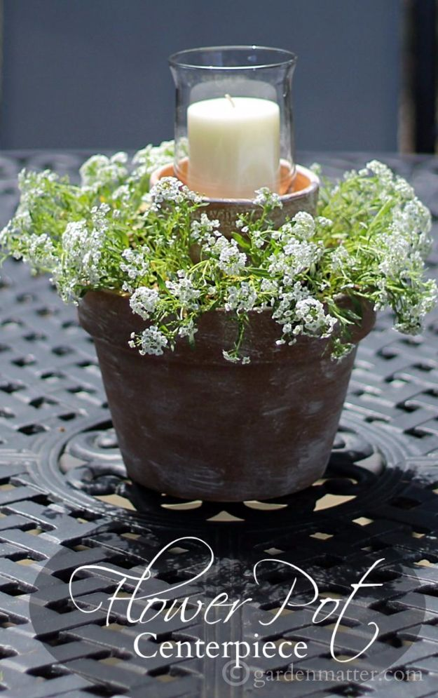 DIY Porch and Patio Ideas - Flower Pot Centerpiece - Decor Projects and Furniture Tutorials You Can Build for the Outdoors - Lights and Lighting, Mason Jar Crafts, Rocking Chairs, Wreaths, Swings, Bench, Cushions, Chairs, Daybeds and Pallet Signs http://diyjoy.com/diy-porch-patio-decor