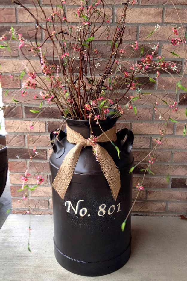 DIY Porch and Patio Ideas - Flower and Branch Milk Can Decoration - Decor Projects and Furniture Tutorials You Can Build for the Outdoors - Lights and Lighting, Mason Jar Crafts, Rocking Chairs, Wreaths, Swings, Bench, Cushions, Chairs, Daybeds and Pallet Signs