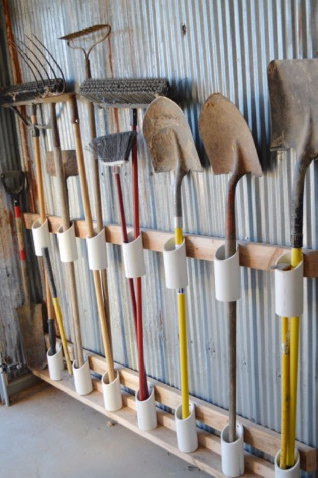 Galvanized Walls With PVC Pipe Tool StoragDIY Projects Your Garage Needs - Galvanized Walls With PVC Pipe Tool Storage - Do It Yourself Garage Makeover Ideas Include Storage, Mudroom, Organization, Shelves, and Project Plans for Cool New Garage Decor - Easy Home Decor on A Budget http://diyjoy.com/diy-garage-idease