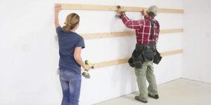 They Nail Boards To Garage Wall. What They Do Next Is Easy, Cheap And Fast!