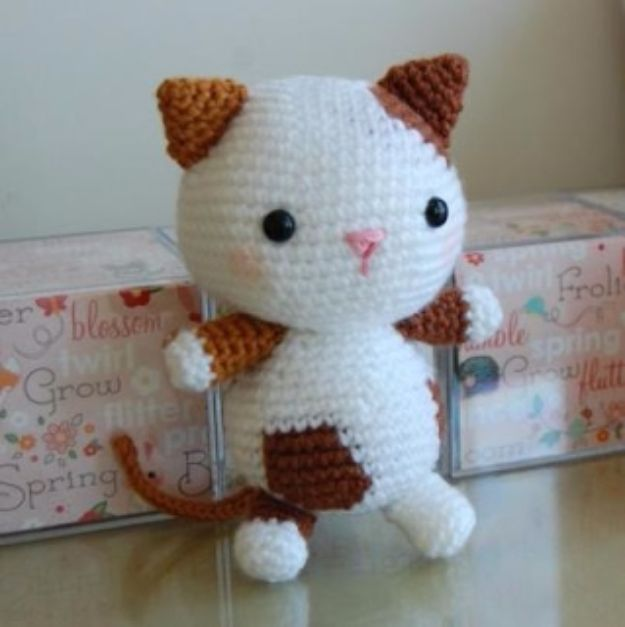 Free Amigurumi Patterns For Beginners and Pros - Kitten Amigurumi - Easy Amigurimi Tutorials With Step by Step Instructions - Learn How To Crochet Cute Amigurimi Animals, Doll, Mobile, Mini Elephant, Cat, Dinosaur, Owl, Bunny, Dog - Creative Ways to Crochet Cool DIY Gifts for Kids, Teens, Baby and Adults http://diyjoy.com/free-amigurumi-patterns