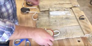 He Uses Pallet Wood And A Mason Jar To Make An Amazing Item For His Decor That You're Gonna Want!