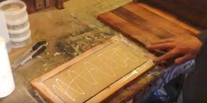 After He Nails And Stains Pallet Wood, Then He Glues An Item To It That You'll Love!