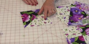 Simply Cut Squares And Long Strips To Make This Gorgeous Pansy Quilt!