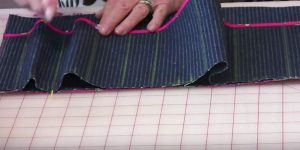 She Sews Down Each Green Line In The Fabric And The Reason She Does This Is So Clever (Watch!)