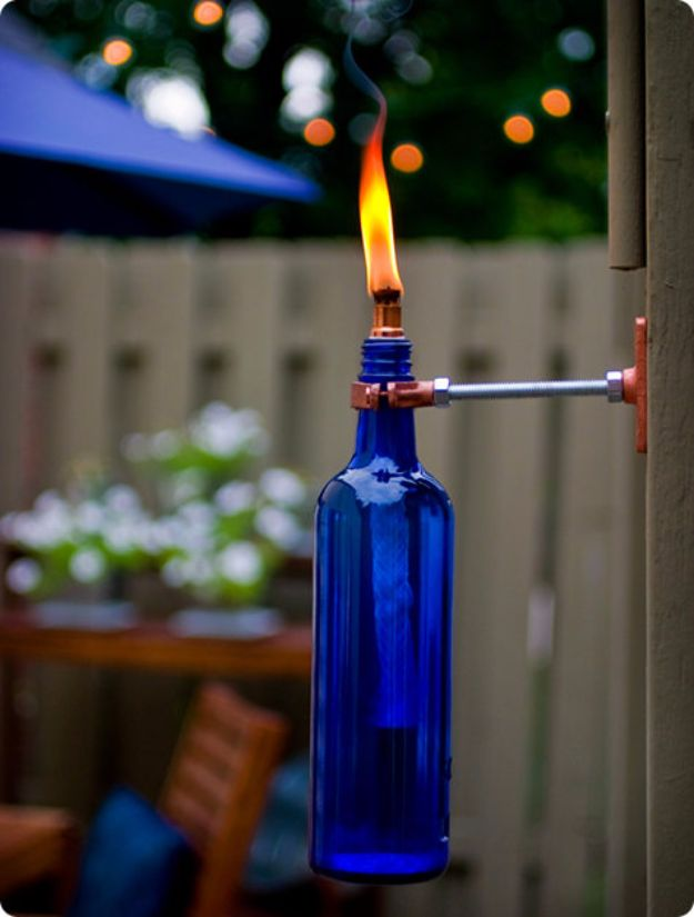 DIY Outdoor Lighting Ideas - Recycled Wine Bottle Torch - Do It Yourself Lighting Ideas for the Backyard, Patio, Porch and Pool - Lights, Chandeliers, Lamps and String Lights for Your Outdoors - Dining Table and Chair Lighting, Overhead, Sconces and Weatherproof Projects - Walkway, Pool and Garden http://diyjoy.com/diy-outdoor-lighting-ideas