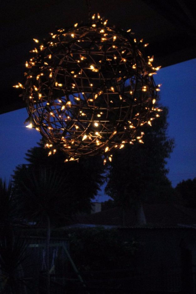 DIY Outdoor Lighting Ideas - Turn Wire Baskets into a Fairy Light Globe - Do It Yourself Lighting Ideas for the Backyard, Patio, Porch and Pool - Lights, Chandeliers, Lamps and String Lights for Your Outdoors - Dining Table and Chair Lighting, Overhead, Sconces and Weatherproof Projects #diy #lighting