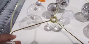 She Attaches Wire To Clear Ball Ornaments And What She Makes Is Absolutely Genius!