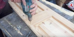 He Takes An Unfinished Wooden Door, Saws Down The Middle And What He Makes Is So Cool!