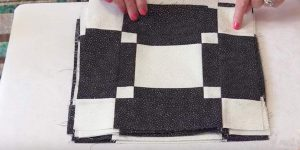 She Cuts Small White Squares And Larger Black Ones And Makes An Item You'll Adore!