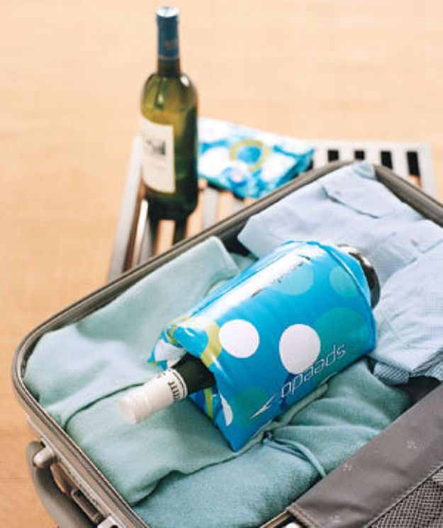 Packing Tips for Travel - Floaties as Wine Bottle Protectors - Easy Ideas for Packing a Suitcase To Maximize Space - Tricks and Hacks for Folding Clothes, Storing Toiletries, Shampoo and Makeup - Keep Clothing Wrinkle Free in Your Bag http://diyjoy.com/packing-tips-travel