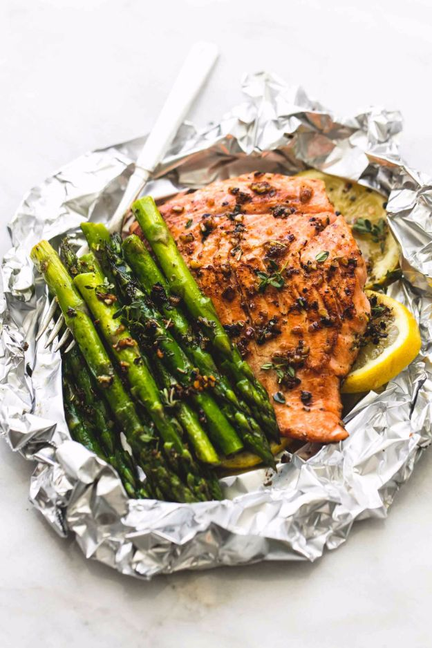 Tin Foil Camping Recipes - Herb Butter Salmon And Asparagus Foil Packs - DIY Tin Foil Dinners, Ideas for Camping Trips and On Grill. Hamburger, Chicken, Healthy, Fish, Steak , Easy Make Ahead Recipe Ideas for the Campfire. Breakfast, Lunch, Dinner and Dessert, Snacks all Wrapped in Foil for Quick Cooking http://diyjoy.com/tinfoil-camping-recipes