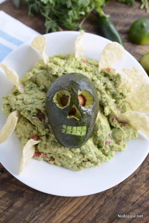 Best Halloween Party Snacks - Holy Skull-y Guacamole - Healthy Ideas for Kids for School, Teens and Adults - Easy and Quick Recipes and Idea for Dips, Chips, Spooky Cookies and Treats - Appetizers and Finger Foods Made With Vegetables, No Candy, Cheap Food, Scary DIY Party Foods With Step by Step Tutorials #halloween #halloweenrecipes #halloweenparty