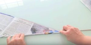 She Rolls Up Newspapers With A Skewer And It's Amazing What She Does Next. Watch!