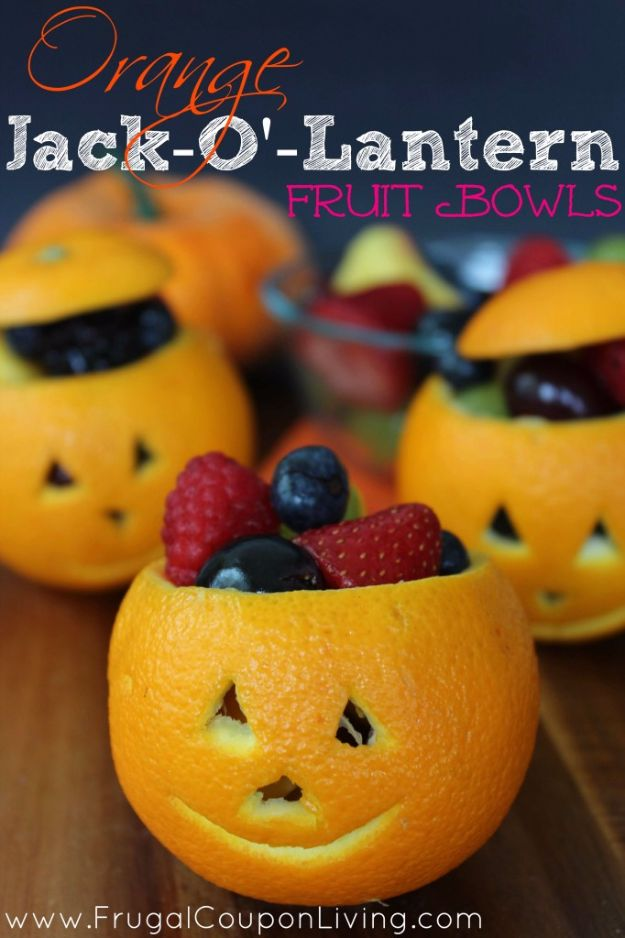 Healthy Halloween Party Recipe Ideas - Orange Jack-O'-Lantern Fruit Bowl - Healthy Ideas for Kids for School, Teens and Adults - Easy and Quick Recipes and Idea for Dips, Chips, Spooky Cookies and Treats - Appetizers and Finger Foods Made With Vegetables, No Candy, Cheap Food, Scary DIY Party Foods With Step by Step Tutorials #halloween #halloweenrecipes #halloweenparty