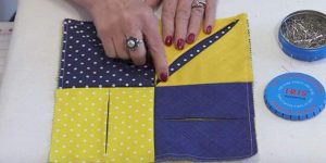 She Folds Back A Piece Of Fabric To Show You How To Make A Special Item You'll Want!