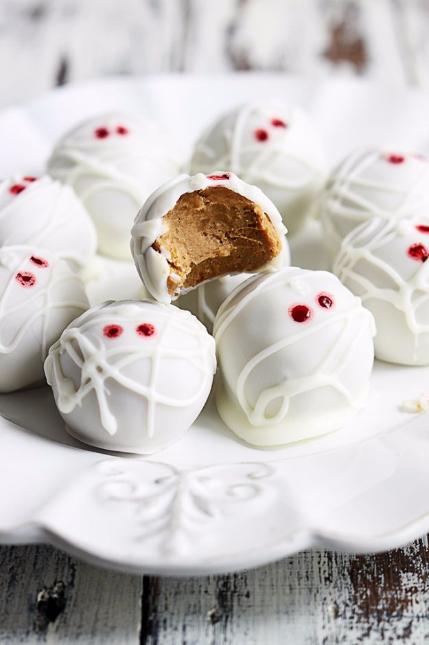 Best Halloween Party Snacks - Pumpkin Cheesecake Truffle Mummies - Healthy Ideas for Kids for School, Teens and Adults - Easy and Quick Recipes and Idea for Dips, Chips, Spooky Cookies and Treats - Appetizers and Finger Foods Made With Vegetables, No Candy, Cheap Food, Scary DIY Party Foods With Step by Step Tutorials http://diyjoy.com/halloween-party-snacks
