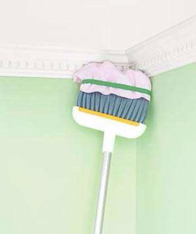 Cleaning Tips and Tricks - Broom as Long Distance Duster - Best Cleaning Hacks, Recipes and Tutorials - Daily Ways to Clean For Kitchen, For Couches, Bathroom, Bedroom, Laundry, Floors, Furniture, Windows, Cleaners and More for Cleaning Your Home- Quick Ideas for Lazy People - Cool Cleaning Hack Tutorial - DIY Projects and Crafts by DIY JOY http://diyjoy.com/diy-cleaning-tips-tricks