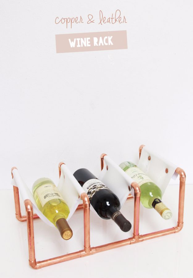 Cheap Wedding Gift Ideas - DIY Copper Pipe & Leather Wine Rack - DIY Wedding Gifts You Can Make On A Budget - Quick and Easy Ideas for Handmade Presents for the Couple Getting Married - Inexpensive Things To Make for Bride and Groom - DIY Home Decor, Wall Art, Glassware, Furniture, Tableware, Place Settings, Cake and Cookie Plates and Glasses http://diyjoy.com/cheap-diy-wedding-gift-ideas