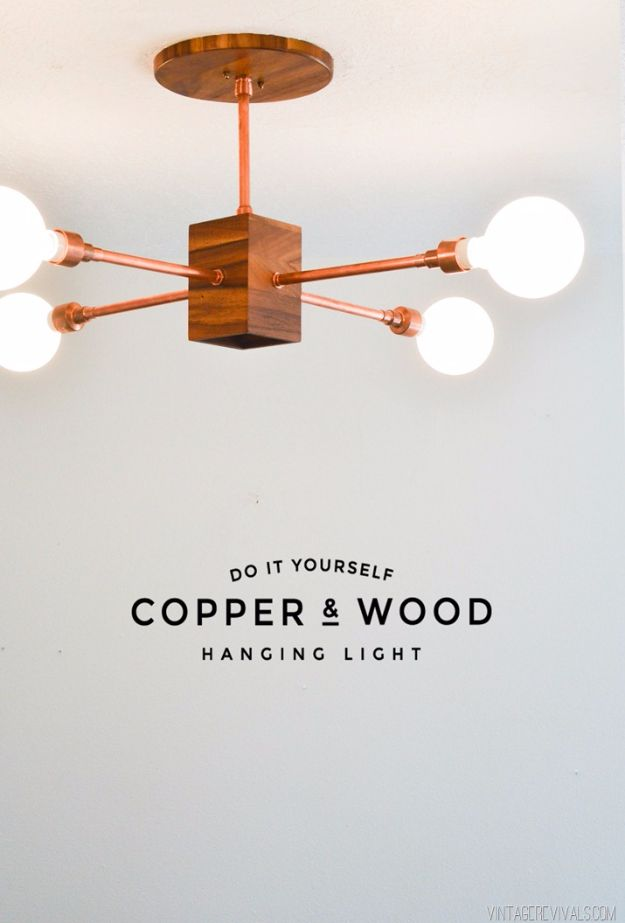 DIY Lighting Ideas and Cool DIY Light Projects for the Home - DIY Copper and Wood Hanging Light Fixture - Easy DIY Ideas for Chandeliers, lights, lamps, awesome pendants and creative hanging fixtures, complete with tutorials with instructions. Cheap do it yourself lighting tutorials for indoor - bedroom, living room, bathroom, kitchen DIY Projects and Crafts for Women and Men http://diyjoy.com/diy-indoor-lighting-ideas