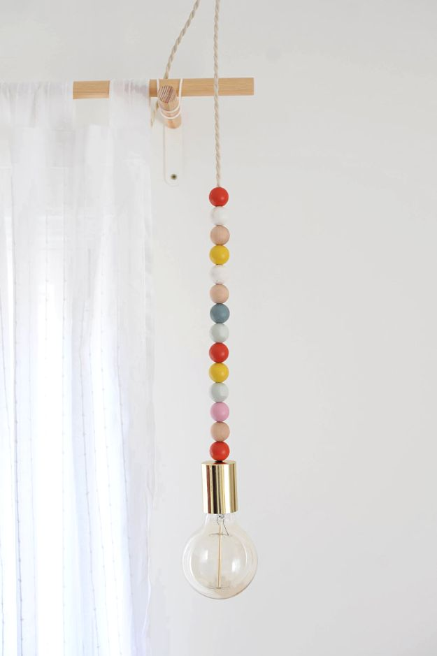 DIY Lighting Ideas and Cool DIY Light Projects for the Home - DIY Wooden Bead Pendant Light - Easy DIY Ideas for Chandeliers, lights, lamps, awesome pendants and creative hanging fixtures, complete with tutorials with instructions. Cheap do it yourself lighting tutorials for indoor - bedroom, living room, bathroom, kitchen DIY Projects and Crafts for Women and Men