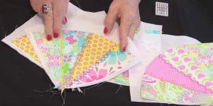 She Cuts From One Corner To The Other, Forming Triangles. What She Makes Is Stunning!