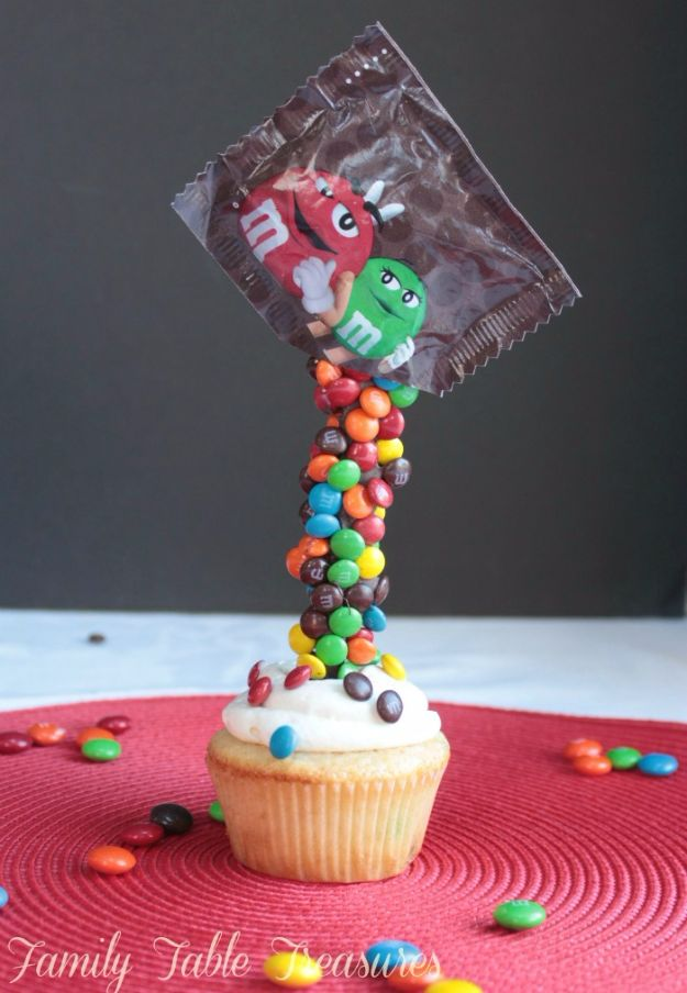 Cool Cupcake Decorating Ideas - Gravity Defying M&M Cupcakes - Easy Ways To Decorate Cute, Adorable Cupcakes - Quick Recipes and Simple Decorating Tips With Icing, Candy, Chocolate, Buttercream Frosting and Fruit - Best Party and Birthday Party Ideas for Kids and Adults http://diyjoy.com/cupcake-decorating-ideas