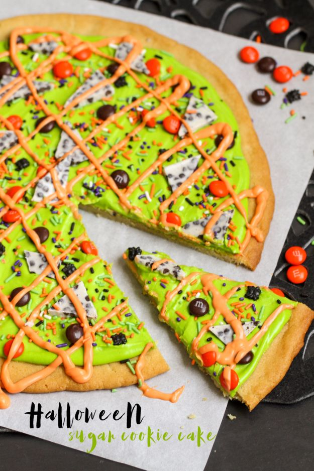 Cute Halloween Cookies - Halloween Sugar Cookie Cake - Easy Recipes and Cookie Tutorials for Making Quick Halloween Treats - Spooky DIY Decorated Ghosts, Pumpkins, Bats, No Bake, Spiders and Spiderwebs, Tombstones and Healthy Options, Kids and Teens Cookies for School http://diyjoy.com/halloween-cookies-ideas