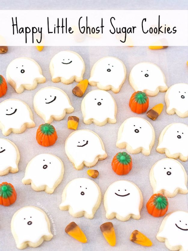 Cute Halloween Cookies - Happy Little Ghost Sugar Cookies - Easy Recipes and Cookie Tutorials for Making Quick Halloween Treats - Spooky DIY Decorated Ghosts, Pumpkins, Bats, No Bake, Spiders and Spiderwebs, Tombstones and Healthy Options, Kids and Teens Cookies for School #halloween #halloweencookies