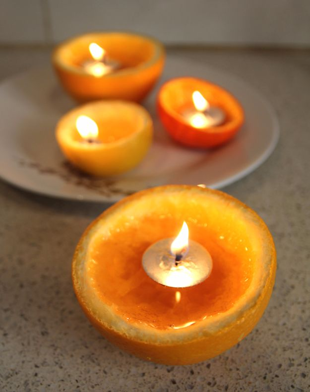 DIY Ideas for Candles - Orange Peel Candle - Cute, Cheap and Creative Ways to Decorate With Candles - Votives and Candle Holders Make Some Of Our Favorite Home Decor Ideas and Homemade Do It Yourself Gifts - Give One of These Inexpensive Ideas to Mom, Dad and Friends - Easy Dollar Store Crafts With Candle http://diyjoy.com/diy-ideas-candles