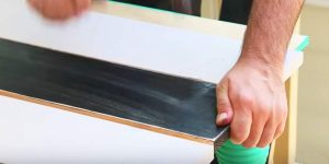 He Paints Boards Black And White And Watch How He Gives An Old Patio Table A Makeover!