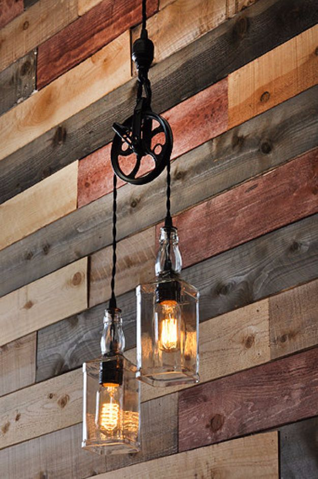 DIY Lighting Ideas and Cool DIY Light Projects for the Home - Whiskey Bottle Lights with Vintage Pulley - Easy DIY Ideas for Chandeliers, lights, lamps, awesome pendants and creative hanging fixtures, complete with tutorials with instructions. Cheap do it yourself lighting tutorials for indoor - bedroom, living room, bathroom, kitchen DIY Projects and Crafts for Women and Men