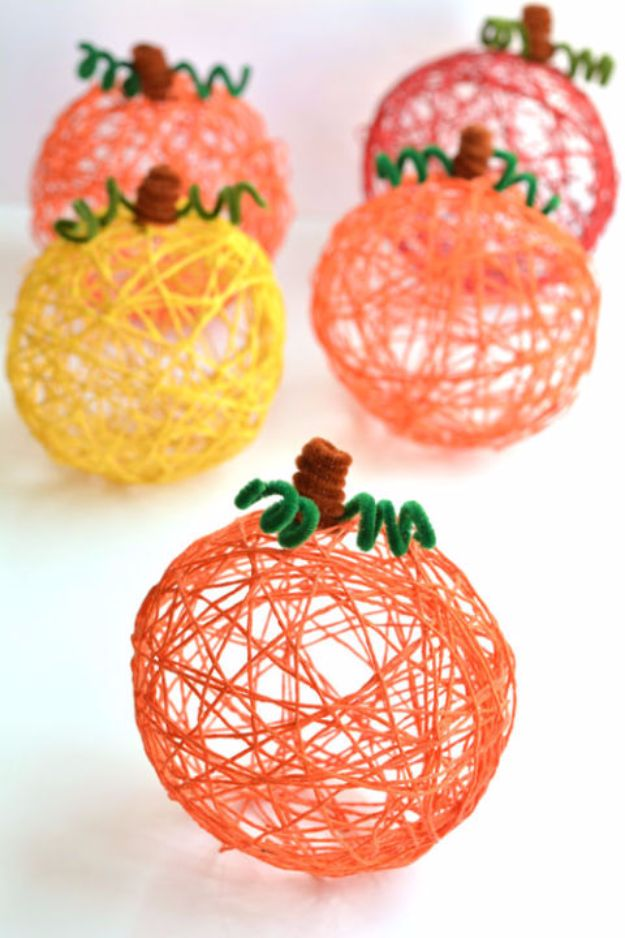 Best Crafts for Fall Decorating - Yarn Pumpkins Using Balloons - DIY Home Decor, Mason Jar Ideas, Dollar Store Crafts, Rustic Pumpkin Ideas, Wreaths, Candles and Wall Art, Centerpieces, Wedding Decorations, Homemade Gifts, Craft Projects with Leaves, Flowers and Burlap, Painted Art, Candles and Luminaries for Cool Home Decor - Quick and Easy Projects With Step by Step Tutorials and Instructions http://diyjoy.com/best-fall-decorating-ideas
