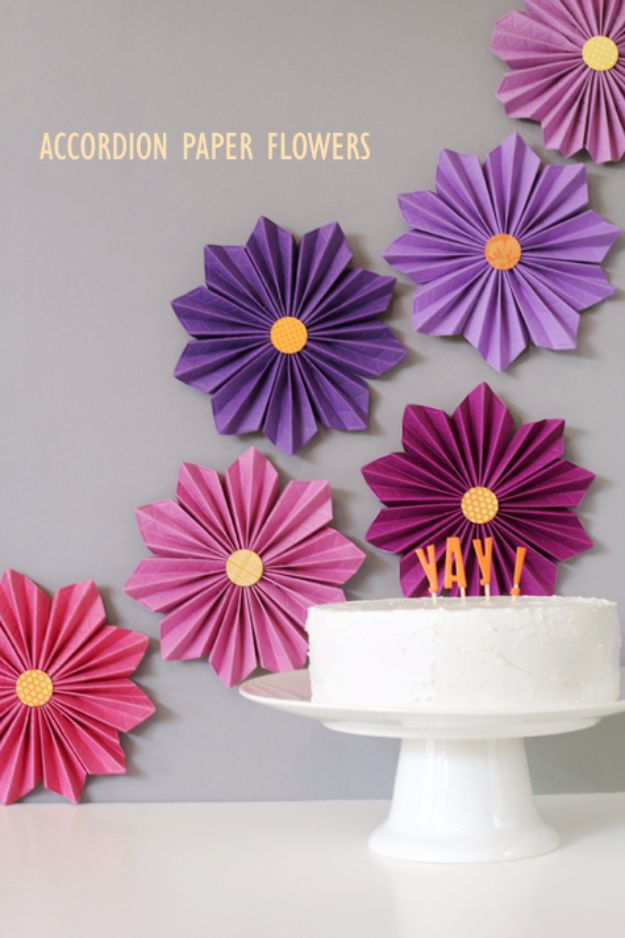 DIY Paper Flowers - Accordion Paper Flowers - How To Make A Paper Flower - Large Wedding Backdrop for Wall Decor - Easy Tissue Paper Flower Tutorial for Kids - Giant Projects for Photo Backdrops - Daisy, Roses, Bouquets, Centerpieces - Cricut Template and Step by Step Tutorial http://diyjoy.com/diy-paper-flowers