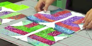 She Cuts Strips Of Fabric, Arranging In A Design We All Love, Making An Amazing Quilt!
