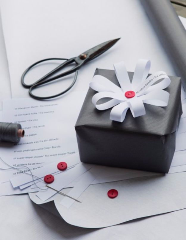 Creative Bows For Packages - Button Ribbon Loop Bow - Make DIY Bows for Christmas Presents and Holiday Gifts - Cute and Easy Ideas for Making Your Own Bows and Ribbons - Step by Step Tutorials and Instructions for Tying A Bow - Cheap and Crafty Gift Wrapping Ideas on A Budget http://diyjoy.com/diy-bows-gifts-packages