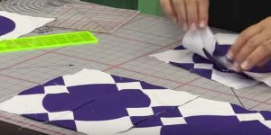 She Cuts 8″ Strips, Cuts Those Into Squares Making A Strikingly Crisp Looking Quilt!