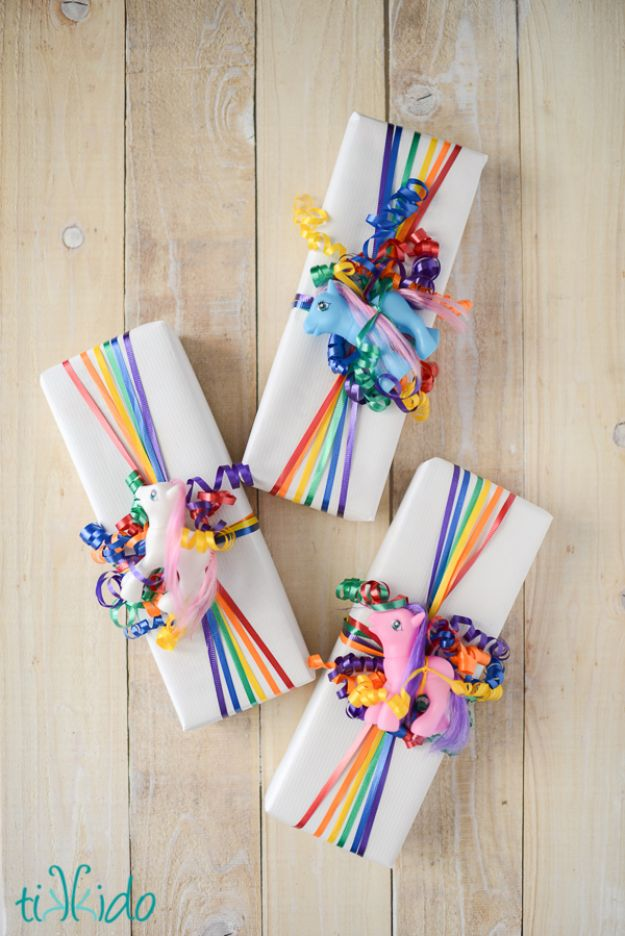 Cool Gift Wrapping Ideas - Easy Rainbow Ribbon Gift Wrap - Creative Ways To Wrap Presents on A Budget - Best Christmas Gift Wrap Ideas - How To Make Gift Bags, Reuse Wrapping Paper, Make Bows and Tags - Cute and Easy Ideas for Wrapping Gifts for the Holidays - Step by Step Instructions and Photo Tutorials http://diyjoy.com/gift-wrapping-tutorials